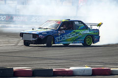 Modified car drifting with smoke Stock Photography