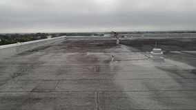 Modified flat roof; commercial roofing leak repairs Stock Photography