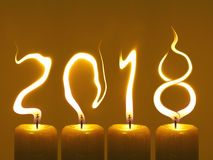 Happy new year 2018 - candles. Modified photo of four candles. Flames write numbers 2018. Happy new year 2018 Royalty Free Stock Photos