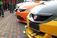 Modified Sports Cars. Image of a row of modified sports cars parked in an autoshow event stock photography
