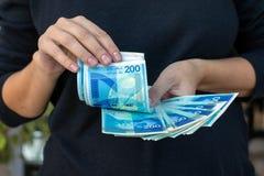 Free Modiin / Israel - November 4 2019: Two Woman Hands Counting Many 200 Israel Shekel Banknotes. Stock Images - 168154604
