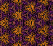 Modish seamless ornamental pattern of fractal shapes in violet, orange and black shades Royalty Free Stock Photography
