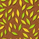 Modèle sans couture avec des feuilles d'automne sur le brun Images libres de droits