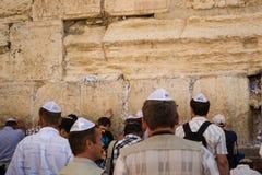 Modlitwa przy wy ścianą Zdjęcie Royalty Free