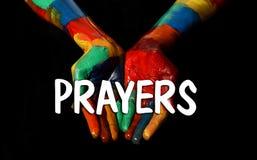 Modlitwa wizerunek z malującym ręki zakończeniem up zdjęcia stock