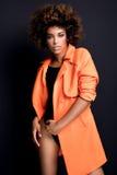 Modna kobieta w pomarańczowym żakiecie Zdjęcia Stock