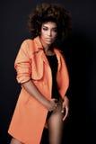 Modna kobieta w pomarańczowym żakiecie Zdjęcia Royalty Free
