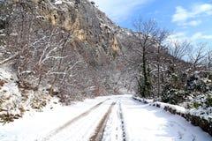 Modo giù nella neve Immagine Stock