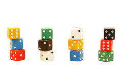 Modular combinations. 4 accumulations of 3 coloured dice each isolated on white background stock image