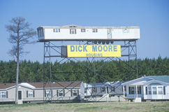 Modular home elevated on scaffold structure advertising Dick Moore Housing company, MS Stock Image