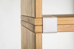 Module furniture clamp. Wooden loft furniture clip. Clamped wood furniture modules. Bonding two boards with clamps Royalty Free Stock Photo