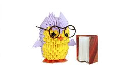 Module origami owl. Reading a book in the big black glasses stock photos