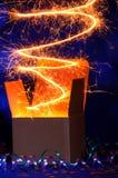 Module ouvert de boîte en carton avec la lumière rougeoyante Image libre de droits