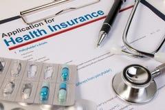 Modulo di domanda per assicurazione malattia Fotografia Stock