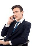 Młody biznesmen opowiada na telefonie. Zdjęcie Royalty Free