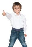 Mody chłopiec trzyma jego kciuk up Obraz Royalty Free