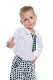 Mody chłopiec trzyma jego kciuk up Obraz Stock