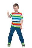 Mody chłopiec trzyma jego kciuk up Fotografia Stock