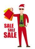 Młody Człowiek W Santa kostiumu z torba na zakupy wewnątrz Obrazy Stock