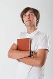 Młody człowiek z książką Obrazy Royalty Free