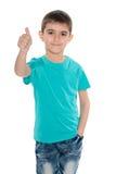 Mody młoda chłopiec trzyma jego kciuk up obraz royalty free