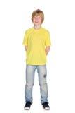 Mody młoda chłopiec w żółtej koszula obrazy royalty free