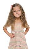 Mody preschool dziewczyna na bielu obraz stock