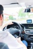 Młody taksówkarz jedzie jego samochód Zdjęcia Royalty Free