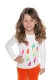 Mody urocza mała dziewczynka przeciw bielowi Fotografia Stock