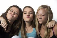 Młodzi Ładni nastolatkowie robi śmiesznym twarzom Obraz Royalty Free