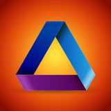 Moebius origami colorful paper triangle on maroon  Stock Images