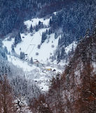 Moeciu village in winter. Village of Moeciu in Brasov county, Romania, during wintertime, seen from high altitude Stock Photos