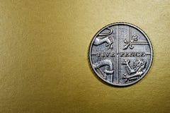 Moeda britânica Sterling Coin de cinco 5 moedas de um centavo Foto de Stock