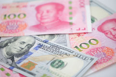 Moeda chinesa e americana Foto de Stock Royalty Free