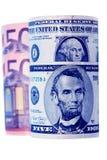 Moeda, dólares e euro em um fundo branco Foto de Stock Royalty Free