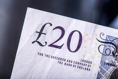 Moeda da libra, dinheiro, cédula Moeda inglesa Cédulas BRITÂNICAS de valores diferentes empilhadas em se Imagem de Stock