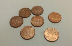 Moeda das moedas de um centavo do Bahamas imagem de stock royalty free