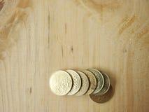 Moeda de bronze dourada fotografia de stock royalty free