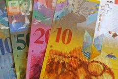Moeda de papel como o dinheiro, francos suíços do fundo Fotos de Stock