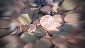Moeda de um centavo e duas moedas das moedas de um centavo Imagens de Stock