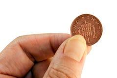Moeda de um centavo a gastar Imagem de Stock Royalty Free
