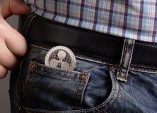 Moeda de XRP em calças de brim do bolso fotos de stock