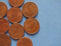 1 moeda do centavo, União Europeia, lado comum sobre o azul com termas da cópia Fotos de Stock Royalty Free