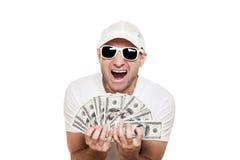 Moeda do dólar da terra arrendada do homem nas mãos Fotos de Stock Royalty Free