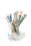 A moeda dobrou-se em um vidro Fotos de Stock Royalty Free
