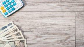 Moeda e calculadora do iene japonês Foto de Stock