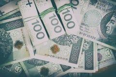 Moeda polonesa PLN, dinheiro Arquive o rolo das cédulas de 100 PLN P Imagens de Stock Royalty Free
