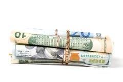 A moeda rolou nos tubos Fotografia de Stock