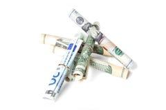 A moeda rolou nos tubos Imagem de Stock Royalty Free