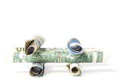 A moeda rolou nos tubos Foto de Stock Royalty Free